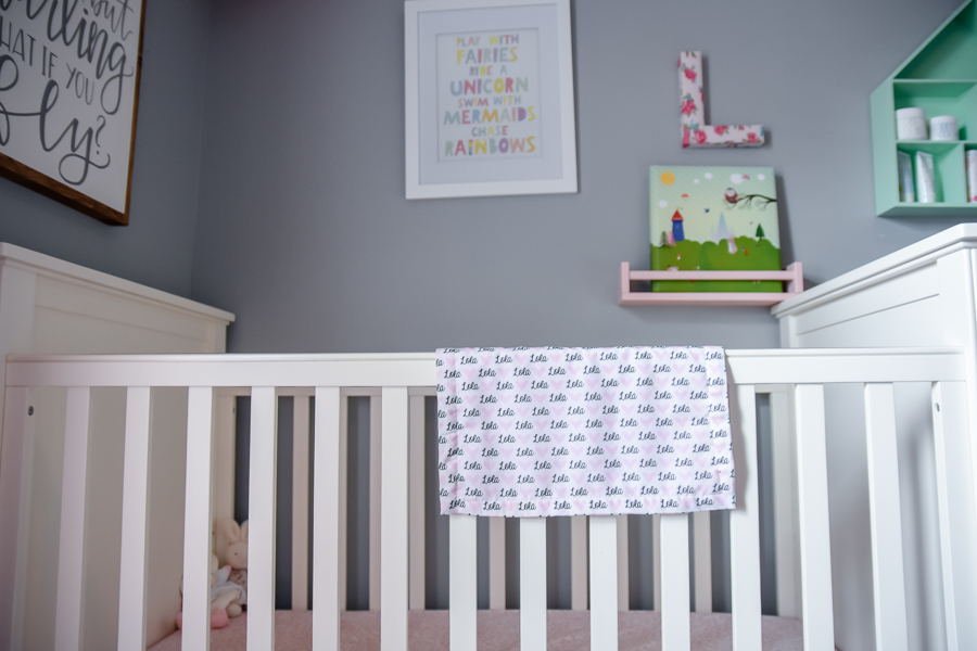 Crib and gallery wall