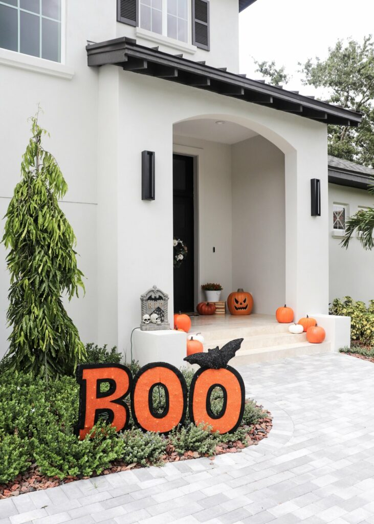 Fall flowers, light up jack-o-lantern, patio ideas, halloween decor